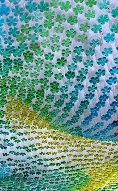 Canopy created by recycled bottles with colored water - beautiful!