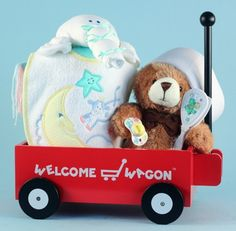 """Welcome Wagon Baby Shower Gift -- Our adorable little red """"Welcome Wagon"""" has been a popular baby gift choice for almost 30 years!   Over that period we've sold more than 100,000 baby gifts in different configurations using this classic wagon toy as the centerpiece.  This particular model Welcome Wagon baby gift presented in gender neutral colors makes a perfect baby shower gift."""