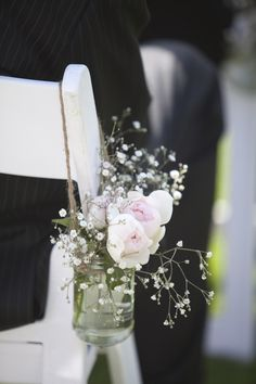 Really beautiful and simple wedding love the flowers dress everything!