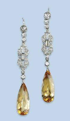 A PAIR OF TOPAZ AND DIAMOND EARRINGS   Each pear-shaped honey-yellow coloured topaz suspended from a slender diamond-set surmount