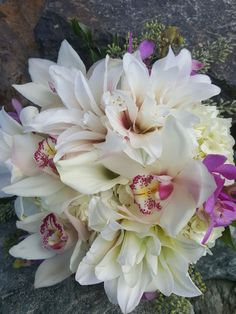 Gorgeous all white hand-tied #bridal #bouquet perfect for the all white #bride #lilies #Orchids #roses