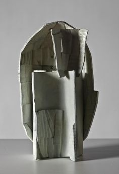 Ricky Swallow : mask with stand (patinated bronze). Looks like it's cast from a maquette made from cardboard. Hmm....