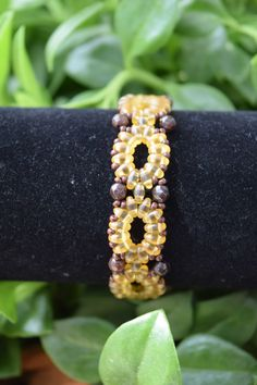 Superduo Bracelet, Beaded Bracelet, Brown & Gold Bracelet, Amber Bracelet, Seed Bead Bracelet by BeadsOnAWireByLisa on Etsy https://www.etsy.com/listing/287438127/superduo-bracelet-beaded-bracelet-brown