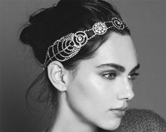 Jennifer Behr :: Hair Accessories  Cosmos Bandeaux  This ornate Swarovski headwrap harnesses the sparkle and allure of the milky way. Finsihed at back with an elastic band. Made by hand in New York City.   $625