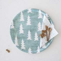 The Sage Green Tray is made from laminated birch with a graphic print of firs inspired by the Scandinavian forest.