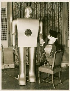 Electro & Sparko - Elektro, one of the most photographed mechanical men, was produced by Westinghouse Electric Corporation in 1939 for the New York World's Fair. Elektro's faithful companion, the dog Sparko, with two motors, could beg, bark and wag his tail.