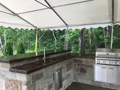 Great outdoor kitchen installed with walttools modular kitchen panels.  note the fully coordinated raised bar.  Have the best outdoor kitchen on your block.