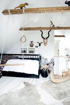Swing, exposed beams, antlers, cowhide rug- not your typical kids room, but it works.