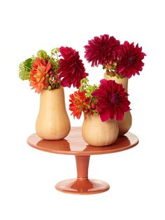Cut off the tops of butternut squash, and spoon out the insides to create vases. #hgtvmagazine #DIY // http://www.hgtv.com/design/make-and-celebrate/entertaining/5-ingredient-or-less-diy-centerpieces-pictures?soc=pinterest