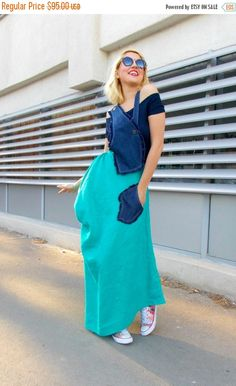 Linen and denim summer maxi dress made of a long linen skirt and a denim upper part. Metal jeans buttons closure. Lateral zip closure. Lateral denim fringes pocket. This product also comes with a navy top. Two pieces included. Material: the denim part: 100% cotton linen skirt part: 100% linen navy top: 95% viscose, 5% elastane  Care instructions: Wash at 30 degrees. The model in the picture is size S.  Can be made in ALL SIZES.  If you have any other specific requirements, do not hesitate to…