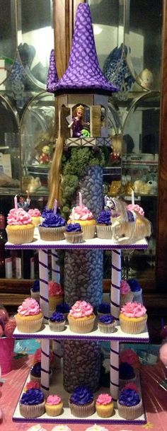 Rapunzel Cupcake Tower by Custom Cakes By Tracee, via Flickr