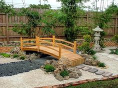This Japanese garden decorated with Japanese pagoda decor and a wooden garden bridge.
