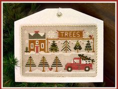 Little House Needleworks Tree Lot - Hometown Holiday - Cross Stitch Pattern. Model is stitched on 30 count Natural Northern Cross Linen using DMC and Classic Co
