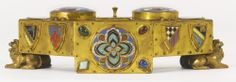 EDWARD F. CALDWELL & CO 1851-1914 A GILT-BRONZE, GILT METAL, APPLIED COLORED STONE AND GLASS CABOCHON, CHAMPLEVÉ AND CLOISONNÉ ENAMEL INKWELL NEW YORK, EARLY 20TH CENTURY two domed inkwells with a central lidded recess engraved E. F. Caldwell & Co. Inc. / New York  height 3 1/4 in.; width 11 in.; depth 4 1/4 in. 8.5 cm; 28 cm; 11 cm