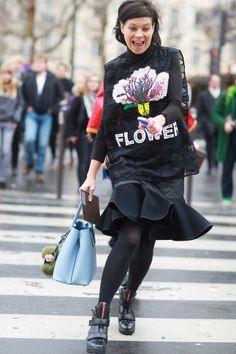 street style: Paris Fashion Week Fall 2014... We're crushing on her Christopher Kane floral tee.  Source: Tim Regas