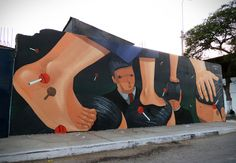 Interesting mural by Peruvian artist Jade spotted in Peru, Lima. The mural can be seen in the district of Chorillos, and incorporates his signature characters.