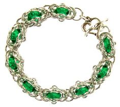 Framed Glass Ring Bracelet by Sarah Austin.  Capture Czech glass rings in a Helms-Byzantine hybrid weave using anodised aluminium jump rings. Free tutorial: http://www.beadsisters.co.uk/library/pages/learnaweave78_framed_glass_ring.htm