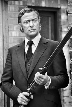 Micheal Caine sporting the heady combination of perfect tailoring and a double barrel shot gun in Get Carter