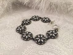 A personal favorite from my Etsy shop https://www.etsy.com/listing/207184156/silver-tone-and-black-snowflake