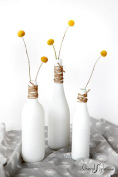 DIY painted bottles wrapped with twine on http://www.cherylstyle.com