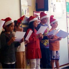 Wearing Christmas hat tasting delicious Kitkat reading new year greeting words guessing the meaning of ancient Chinese pictogram drawings.... Happy Mandarin's Class on Dec.12 2015 before winter break #chineselanguageclass #happymandarin #childrenchineseclasses