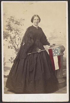 8 by 10 Photo Print Civil War Smiling Woman Holding 11 Star Confederate Flag- much of this ladies attire gives the impression of being of mourning, question is, whom is she mourning. the main question I have is it photo shoped as well as coloured Confederate States Of America, Confederate Flag, Historical Clothing, Historical Photos, Daughter Of The Regiment, Civil War Dress, War Image, Victorian Women, Victorian Dresses