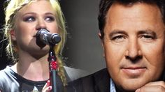 "Kelly Clarkson sings Vince Gill's ""Go Rest High On That Mountain"" in tears to honor a close friend who passed..."
