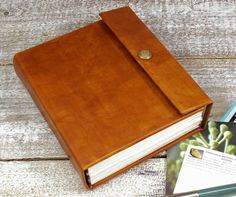 8x10 Plain Leather Journal, Large Leather Bound Journal, Made to Order Full Leather Sketchbook. $225.00, via Etsy.