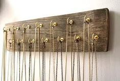 Necklace organizer - may do the alternating hooks with cabinet knobs #necklaceorganizer