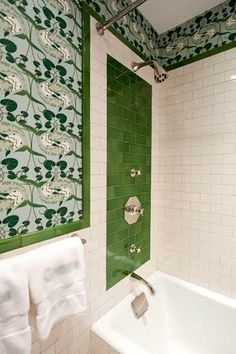 Bathroom wallpaper with lily pads, green tile accents