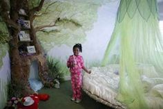 Here is journey's new bed. The tree i am painting in the corner with shelves blending into the branches. Cool!!!!