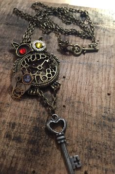 Cleverly designed, handmade pendant of a distinguished steampunk owl in all his sophisticated glory. Includes an owl clock with gears,