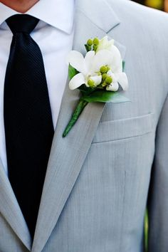 Weddbook ♥ Gray wedding suit, black tie and white fresh flowers boutonniere for grooms. Mens attire trends. Stylish Groom clothing. gray  boutonniere spring tie