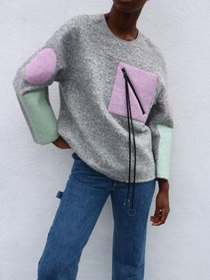 Chelsea Goldman is known for her unique designs and sportswear aesthetic. This patch pullover has both those aspects - the pattern is quirky and fun but it's still downright comfortable. Our favorite part is the front patch pocket with the leather cord detailing that can be tied in multiple ways for infinite styling.