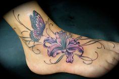 We love the subtle color used for this butterfly and flower. #InkedMagazine #InkedMag #inked #butterfly #flower #floral #butterflies #tattoo #feet #foot #tattoos
