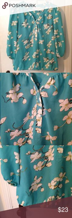 """SALE - PRICE FIRM LOFT Cherry Blossom Print Top Super cute teal and cream print top. 🔹 Bust: 18.5"""" 🔹 Length: 25"""". Elastic on waist and sleeves. Poly fabric. Price firm, no offers please! LOFT Tops Blouses"""