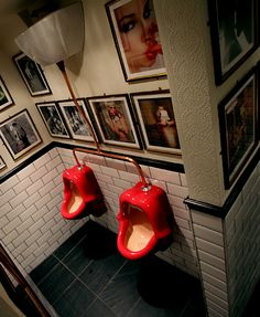 In London - Islington's Hunter S pub, whose gents' urinals are shaped like expectant ruby mouths.