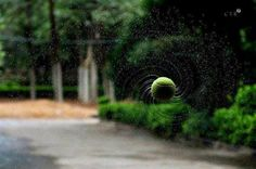 really cool.. and doable. fast shutter speed & a wet spinning tennis ball