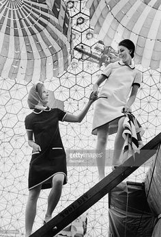 Hostesses in the United States pavilion at Expo 67 show off the light shimmery uniforms they will be wearing during the world exposition in Montreal. The almost-but-not-quite mini dresses will add more lustre to the already spectacular geodesic dome created by American philosopher-scientist Buckminster Fuller.
