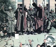 Muslim clerics and army soldiers join hands together to prevent further bloodshed during the 1979 Iranian revolution.