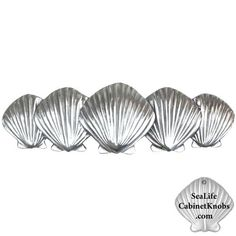 Scallop Shell Drawer Handle 158H   designed and sculpted by Peter Costello. Cast in fine pewter and individually hand finished. Their coastal elegance is as appropriate in formal settings as it is in more casual applications. Availble in various sizes, configurations and finishes. Sold only on the web www.SeaLifeCabine... or call and speake to Peter at 321-749-8918