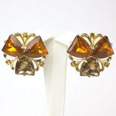 Three-sided glass stones in warm shades of gold and brown form these 1950s three-leaf-clover earrings by Elsa Schiaparelli.