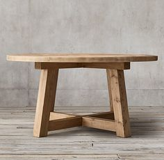 RH's Salvaged Wood Beam Round Dining Table:Our salvaged beam wood tables are handcrafted of unfinished, solid salvaged pine timbers from 100-year-old buildings in Great Britain.