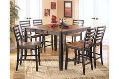 """The Alonzo Counter Height Extension Butterfly Dining Table from Ashley Furniture HomeStore (AFHS.com). With the warm finishes and comfortable contemporary design, the subtle beauty of the """"Alonzo"""" dining room collection features furniture that is sure to enhance the decor of any dining room."""