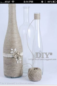 DIY wine bottle.i. Like this idea with a big piece of lace around it. I have 11 empty bottles to use lol