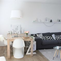 Home white living grey sofa. Verner panton chair and DAR Eames chair