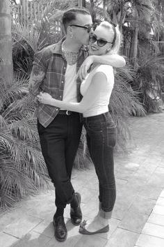Such a cute rockabilly couple. Super simple outfit..cuffed jeans simple tee and flats