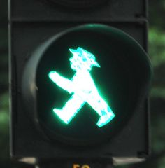 pedestrian light in Berlin, Germany. These guys are called the Ampelmännchen in German