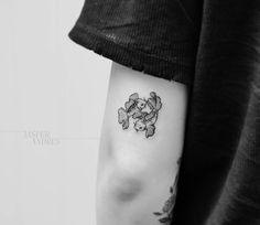 small goldfish emoji tattoo on arm by four_titude