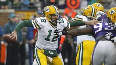 Green Bay Packers quarterback Aaron Rodgers, left, breaks a tackle by Minnesota Vikings defensive tackle Shamar Stephen (93) during the first half of an NFL football game, Sunday, Nov. 23, 2014, in Minneapolis. (AP Photo/Ann Heisenfelt)